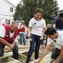 Savannah Guthrie, center, joins Dennis Knowles from Lowe's, left, and Sandy Dias to build a deck as part of Rebuilding Together's volunteer day in Gerritsen Beach in Brookyln, N.Y. to renovate homes damaged by Hurricane Sandy on Thursday, June 6, 2013. (Amy Sussman/AP Images for Rebuilding Together)