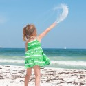 A child throws sand into the wind over BP oil washed ashore in Pensacola, Florida