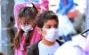 Children wearing masks. AP Photo/Hadi Mizban