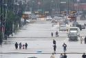 Flooded street with people